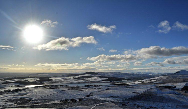The sun begins to light the Lomond Hills, Fife