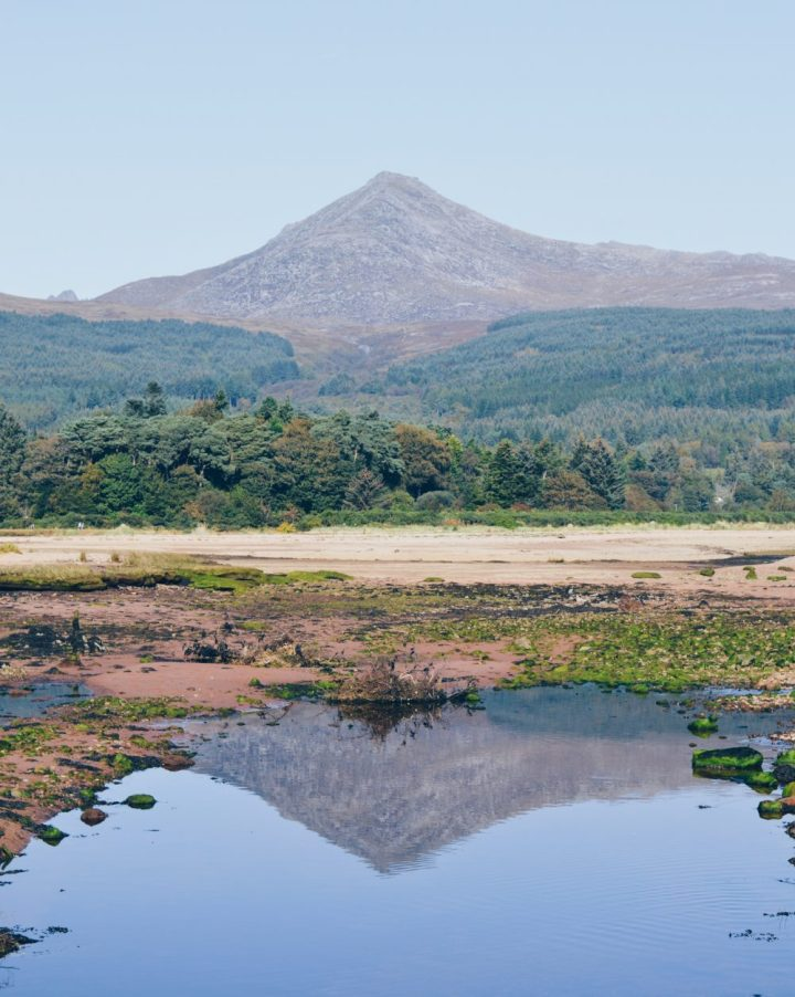 The mountain of Goatfell reflected in water along the Fisherman's Walk, Brodick